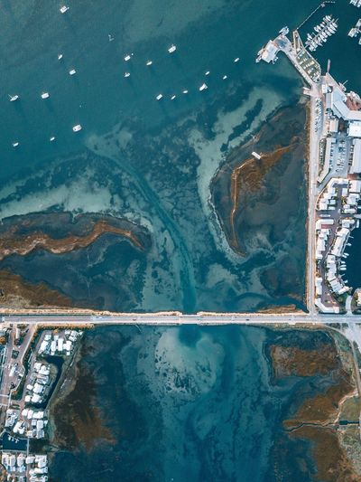 Aerial view of bridge over sea in town