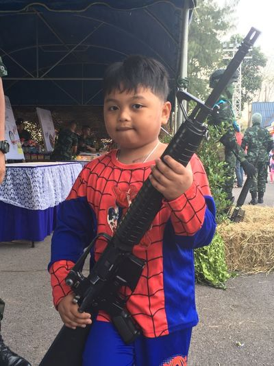 Real People Boys One Person Three Quarter Length Men Portrait Weapon Architecture Holding Childhood Lifestyles Innocence Waist Up Leisure Activity Child