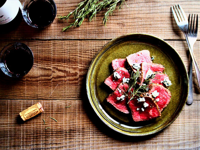 Beef tagliata Composition Dinner Focus On Foreground Food And Drink Food Art Food Styling High Angle View Meat Wine Moments My World Of Food Relaxing Table