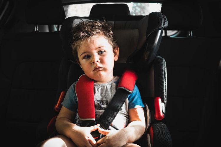 Portrait of boy sitting in car