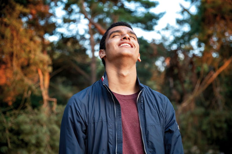 Smiling in the woods EyeEm Selects Men Portrait Handsome Autumn Smiling Tree Eyes Closed  Casual Clothing Growing Sweat Head Back Blooming