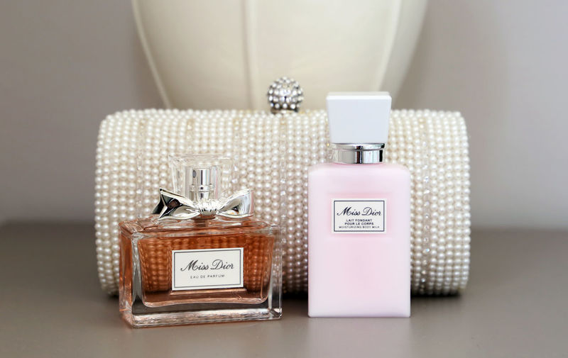 Perfume Body Lotion Perfume Sprayer Container Indoors  No People Still Life Table Text Box Western Script Beauty Product Bottle Box - Container Close-up Communication Pink Color Selective Focus Make-up Seat Business Dior Miss Dior Purse Wedding Gift Wedding Wedding Photography