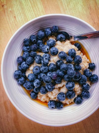 Blueberries on oatmeal Blueberries Oatmeal Food And Drink Food Freshness Blueberry Healthy Eating Fruit Berry Fruit Breakfast Still Life Sweet Food Serving Size Directly Above High Angle View Indoors  No People Close-up Meal Ready-to-eat Table Wellbeing