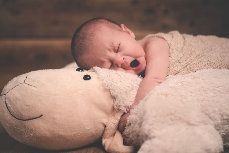 Cute baby boy sleeping in toy