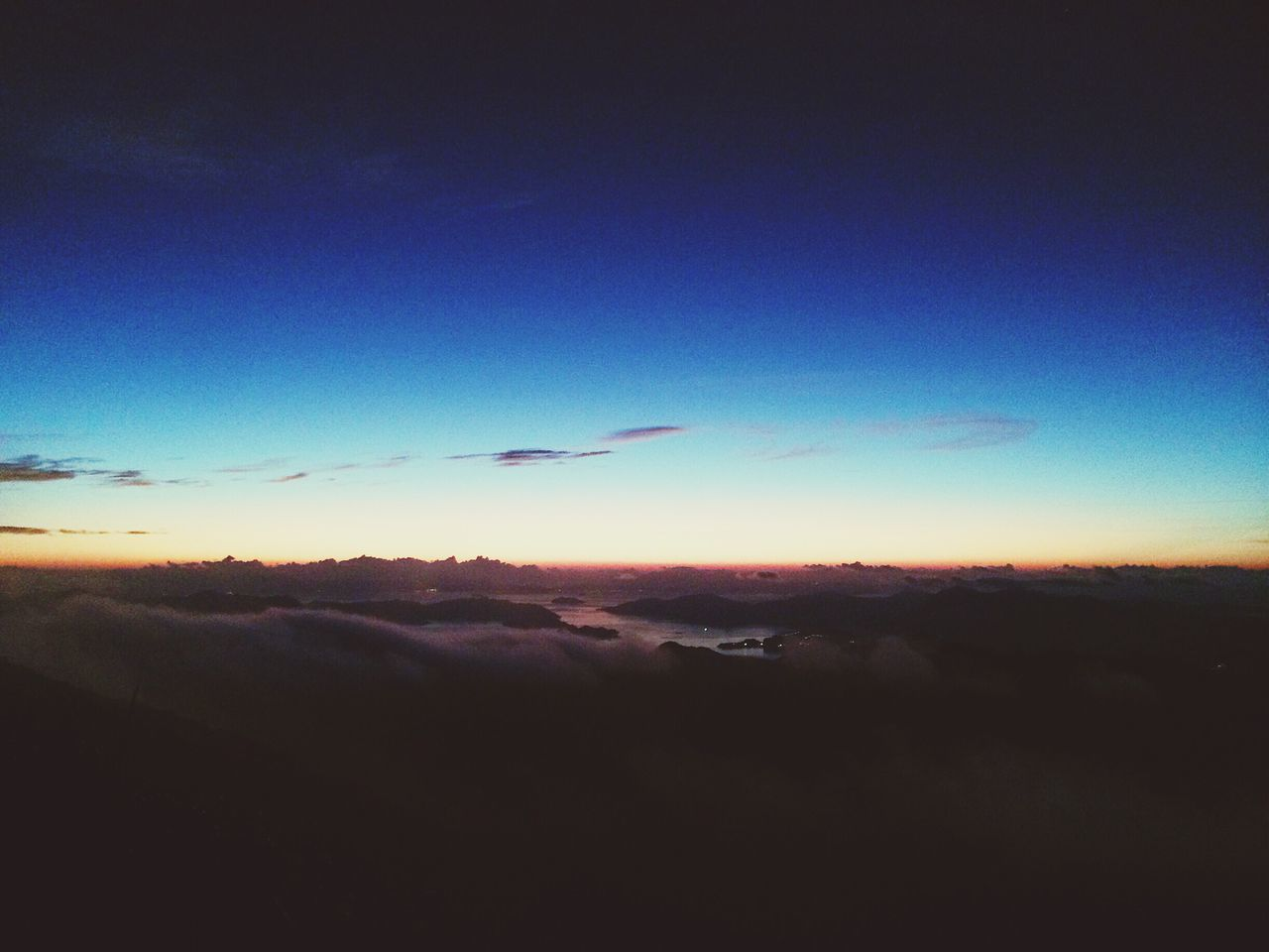 sunset, beauty in nature, nature, sky, scenics, tranquil scene, tranquility, cloud - sky, blue, outdoors, no people, silhouette, sky only, flying, landscape, aerial view, day, bird, airplane wing