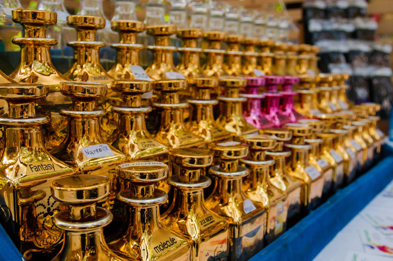 perfume oil Abundance Arrangement Business Choice Consumerism Focus On Foreground For Sale Gold Colored In A Row Indoors  Large Group Of Objects Market Market Stall No People Order Retail  Retail Display Sale Shopping Store Variation