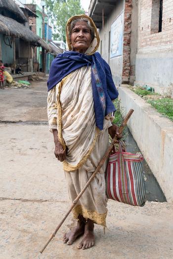 Full length of senior woman on street