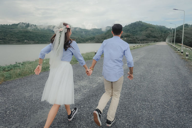 wedding Love Rear View Real People Two People Women Road Couple - Relationship Adult Full Length Positive Emotion Nature Togetherness Walking Day Lifestyles Mountain Outdoors Love Wedding Wellbeing Wedding Photography