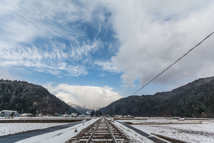railroad track EyeEmNewHere LINE Railroad Track Winter Beauty In Nature Cloud - Sky Mountain Outdoors Sky Snow