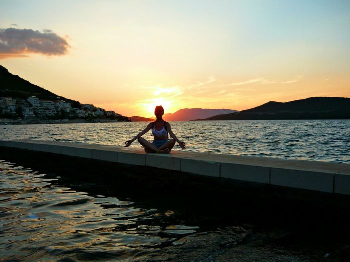 holy water Dusk Idyllic Meditation Men Non-urban Scene Orange Color Outdoors Scenics Sea Shine Bright Shore Silhouette Sky Solitude Summer Holidays Summer Sunset Sunset Tranquil Scene Tranquility Vacations Water Waterfront Yoga Yoga Pose Yogagirl