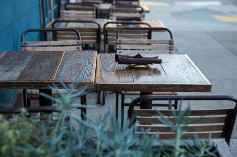 Absence Arrangement Brown And Blue Chair Dinner Table Empty Maroon Color No People Old-fashioned Ready For Customers Restaurant Rusty Seat Sitting Table Table Setting Wood Wood - Material Wooden Showcase: February Your Design Story