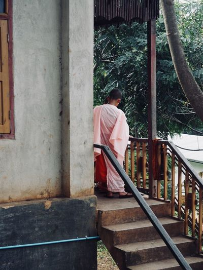 Monk standing on steps at temple