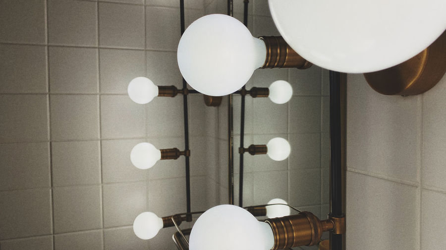Directly above shot of white lights hanging on tiled floor