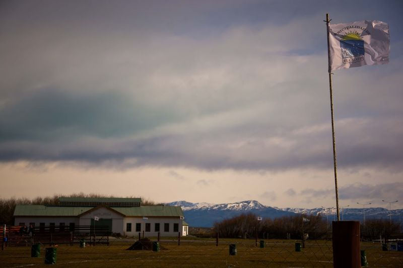 An Argentinian flag moves with the wind, in El Calafate, Santa Cruz, Argentina. Architecture Beauty In Nature Cloud - Sky Day Horizontal Landscape Mountain Nature No People Outdoors Scenics Sky Travel Destinations