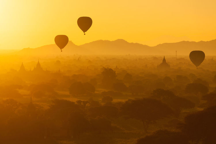 Beautiful landscape morning view of hot air balloon over ancient pagodas of Old Bagan, Myanmar. Bagan Balloon Balloons Buddhism Burma Hot Air Balloon Morning Morning View Myanmar Pagoda Peace Sunrise Temple Tourist Tourist Attraction