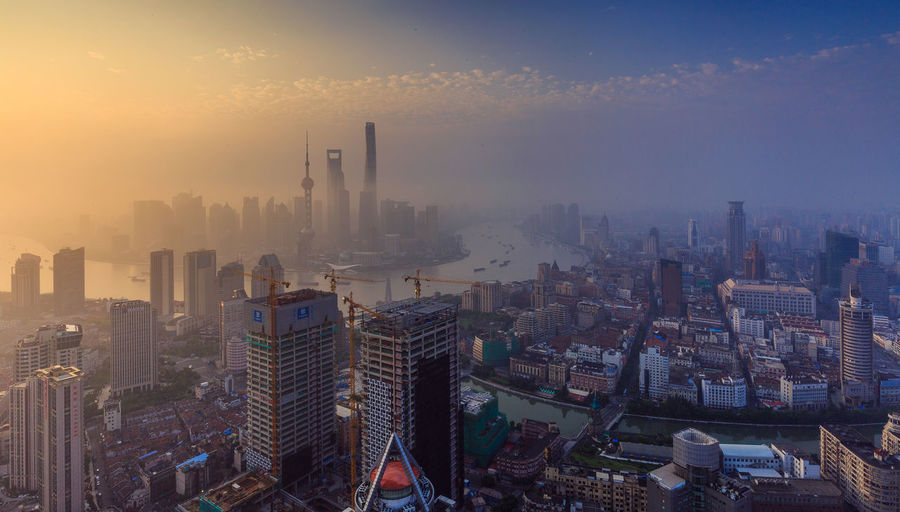 Scenic view of cityscape in foggy weather