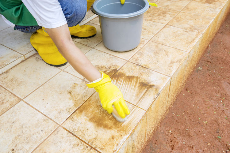 Low section of man working on tiled floor