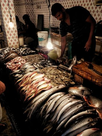 Fish Market Market Food Animal Themes India EyeEm Gallery EyeEmNewHere Marketplace Tamilnadu Streetphotography Working Occupation Men Fish Market Butcher Fishes Shrimp Seafood Fishing Industry Crushed Ice Dead Animal Salmon Market Stall Raw For Sale Lobster Prawn Squid Dried Fish  Small Business Heroes
