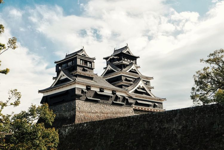 Low angle view of kumamoto castle against sky