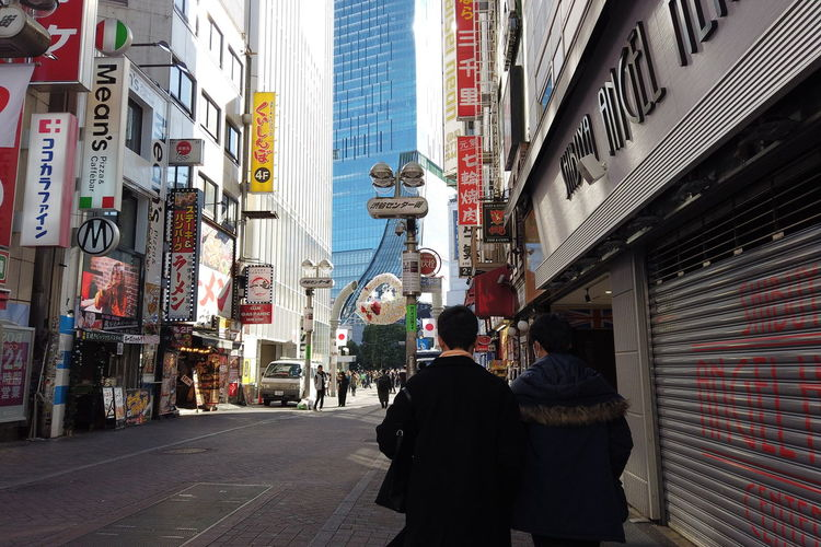 Urban Winter Street City Shibuya Tokyo Japan Shibuya Center-gai Building Exterior Architecture Built Structure Real People Text Group Of People City Life Men People Incidental People Lifestyles Women Communication Rear View Day Adult Building Walking Outdoors