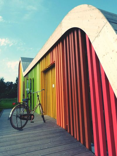 Bicycle beside colorful building