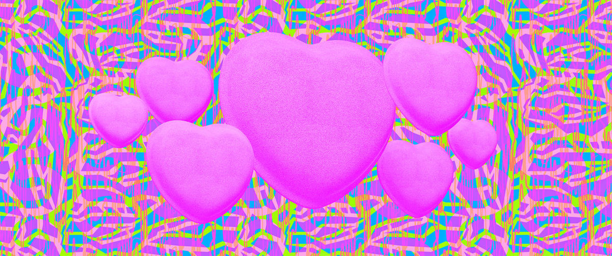 Directly above shot of multi colored heart shape on paper