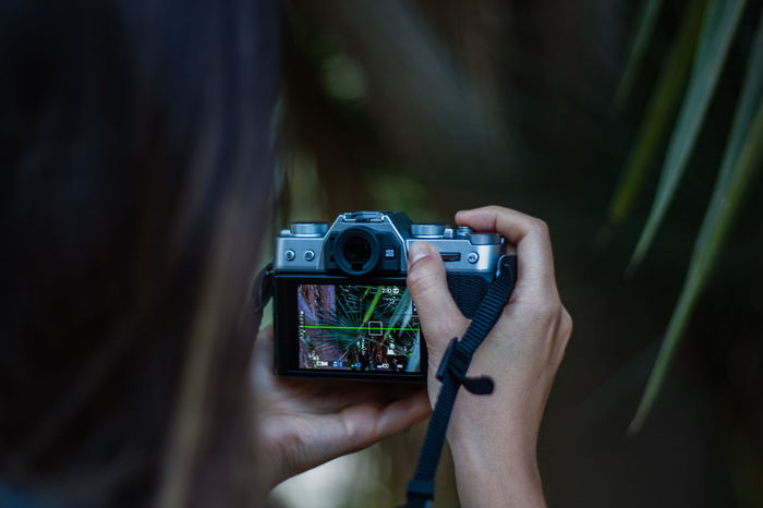 Close-up of woman photographing through camera