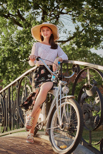 Woman riding bicycle on tree