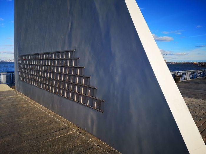 Modern Building By Sea Against Sky
