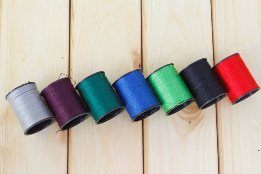 Multi Colored Wood - Material No People Backgrounds Indoors  Close-up Day Thread Threads Lined Up Background Texture Pattern Close Up Photography Artistic Vivid Colours  Colorful Abstract Ordinary  Domestic Hobby Sewing Stuff Sewing Thread Sew Sewing