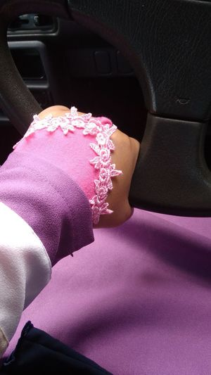 Hand at the steering wheel. Handsock Car Close-up Vehicle Seat Car Interior Dashboard Steering Wheel