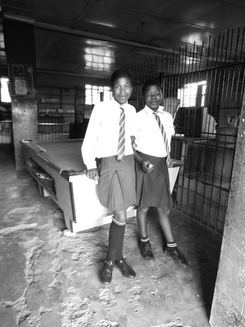 Zulu schoolgirls in a shop in KZN, South Africa. Girls Full Length Indoors  Schoolgirls Kwazulunatal South Africa Zulu
