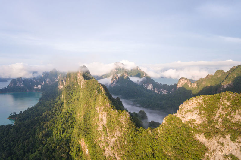Rainforest with limestone mountains surrounding. Sunrise In the south of Thailand Scenics - Nature Beauty In Nature Tranquil Scene Sky Tranquility Water Mountain Cloud - Sky Nature Plant Environment Day Non-urban Scene Tree No People Landscape Land Idyllic Outdoors Mountain Peak
