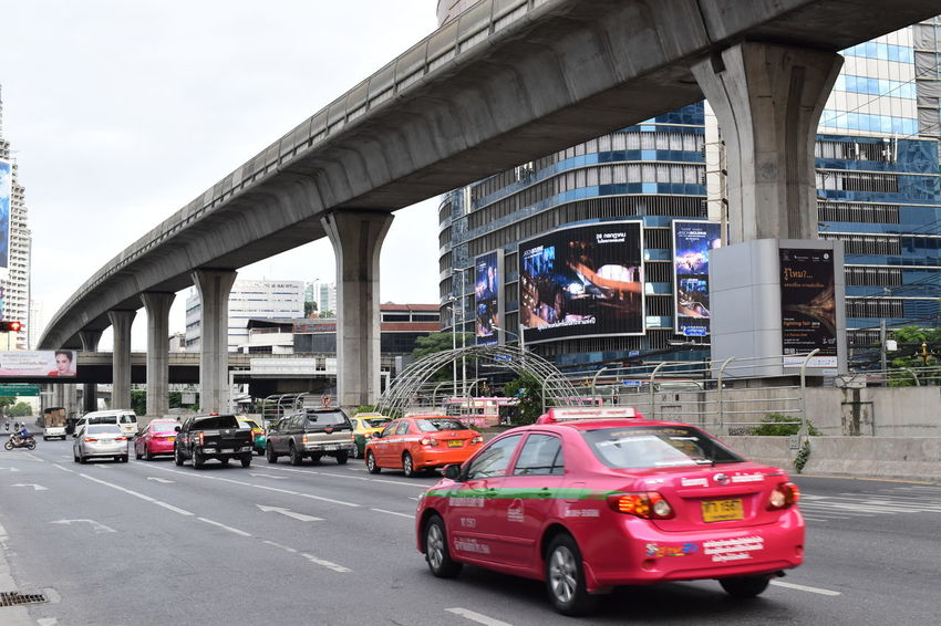 Bangkok street in the morning Architecture Bridge - Man Made Structure Building Built Structure Cars City City Street Day Land Vehicle Outdoors Road Skyscraper Street Taxi Traffic Transportation Transportation Urban The City Light