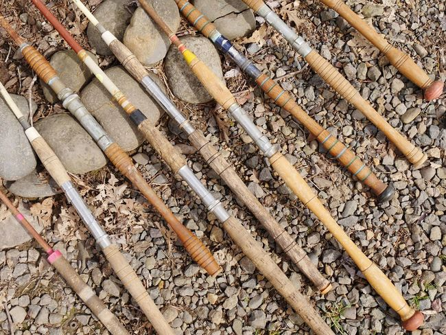 Old fishing poles. Handles Fishing Rod Fishing Pole Wood - Material No People High Angle View Bamboo - Material Day Bamboo Nature Outdoors