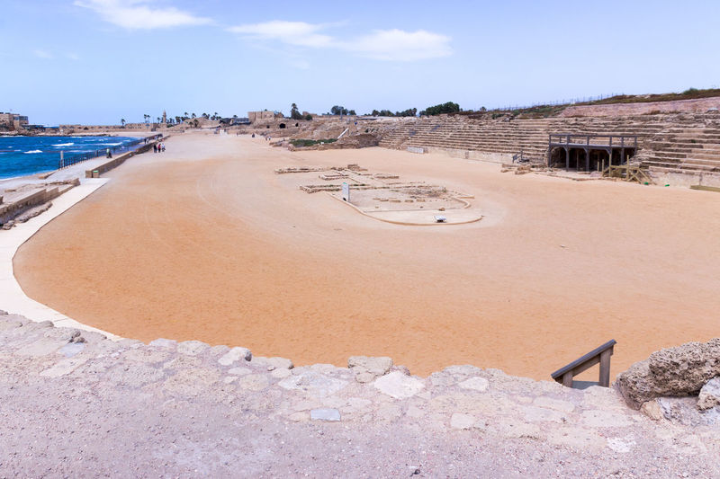 Fragment of the hippodrome in the ruined city of Caesarea in Israel. Antique Architecture Athlete Audience Building Caesarea Chariot Civilization Construction Culture Famous Fragment Game Hippodrom History Horse Israel Mediterranean  Old Rider Ruined Stone Tourism Travel Tribune