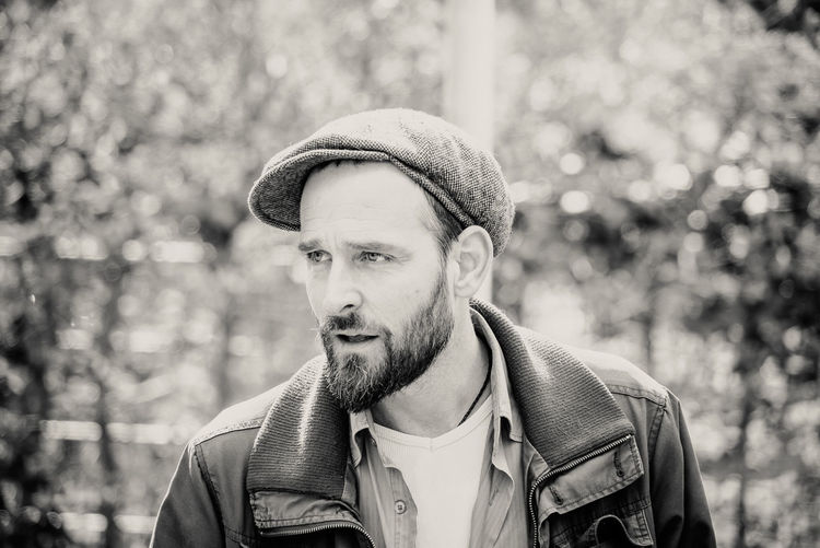 Adult Band Beard Day Desaturated Flat Cap Handsome Headshot Hipster - Person Knit Hat Men Music One Man Only One Person Only Men Outdoors People Pfoc.de Pockets Full Of Change Portrait Retro Styled Singer  Street Street Photography Streetphotography