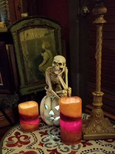 Ahead of Schedule for Halloween Skeleton Skeletonthinker Too Much Time On One's Hands Philosopher Philosophy Philosophical Philosophicalthoughts Waitingforanswers Perfume Statue Halloween Gold Colored Close-up Candlelight Candle Figurine  Evil Demon - Fictional Character Monster - Fictional Character Lit