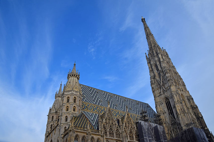 St. Stephen's Cathedral (German title: Stephansdom) at Stephansplatz, the biggest cathedral and most important religious building in Vienna, Austria. One of the most remarkable tourist attractions and one of the city's most recognizable symbols. Architecture Blue Building Building Exterior Built Structure Christianity City Clock Clock Tower Day History Landmark Low Angle View No People Religion Religious Architecture Sky St. Stephan Cathedral Stephansdom Stephansplatz Ststephanscathedral Tourist Attraction  Tower Travel Travel Destinations