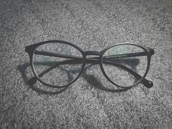 High angle view of eyeglasses on street