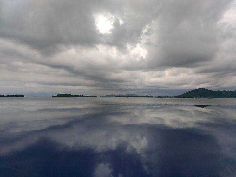 Dramatic Sky Landscape Tranquility Tranquil Scene Cloudscape Scenics Reflection Cloud - Sky Sea Idyllic Beauty In Nature Beach Travel Destinations Outdoors Nature Vacations Awe Horizon Over Water Ethereal No People No Effects No Filter Perspectives On Nature Wonderful Indonesia INDONESIA