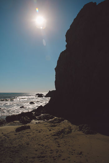 California El Matador Beach Beach Beauty In Nature Clear Sky Day Horizon Over Water Moon Nature No People Outdoors Rock - Object Sand Scenics Sea Sky Sun Sunlight Tranquil Scene Tranquility Water