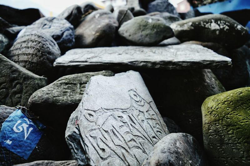 Stone - Object Creativity Stone Focus On Foreground Extreme Close Up Grey Buddhism Culture Indiaincredible Travel No People Variation Indianculture Buddhist Wisdom Built Structure Stone Sculpture Engraved In The Rock Engraved Stones Engraving
