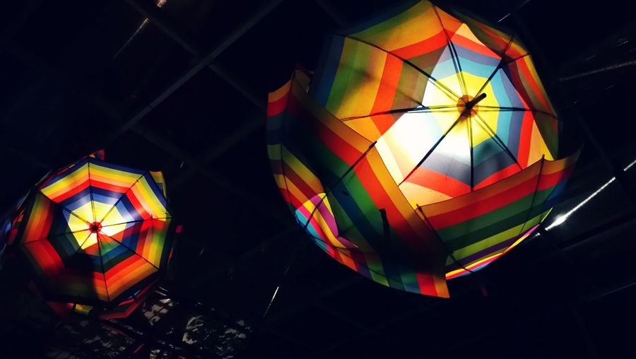 Low angle view of illuminated lanterns at night