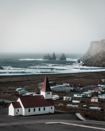 Road trip Building Exterior Architecture Water Sky Built Structure Sea Building Nature Fog No People Scenics - Nature Day Cold Temperature Land City Winter Horizon Over Water Beauty In Nature Outdoors Vík í Mýrdal Iceland EyeEm Best Shots EyeEm Nature Lover EyeEm Selects Travel