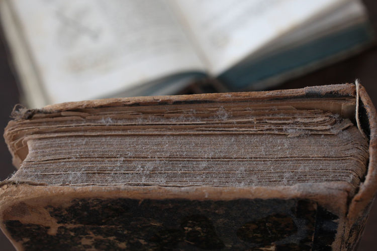 old books piled on a wooden table Antique Books Bookshelf Bookshelfs Learning Library Read Reading Book Close Up Collection Cover Culture Dusty Indoors  No People Old Piled Reading A Book Traditional Wood - Material