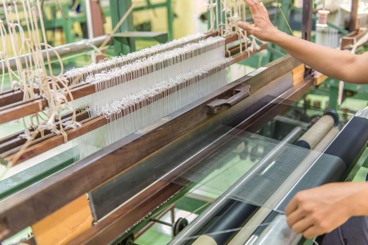 Business Equipment Factory Finger Hand Holding Human Body Part Human Hand Industry Loom Machinery Manufacturing Equipment Occupation One Person Production Line Real People Textile Textile Industry Thread Weaving Working