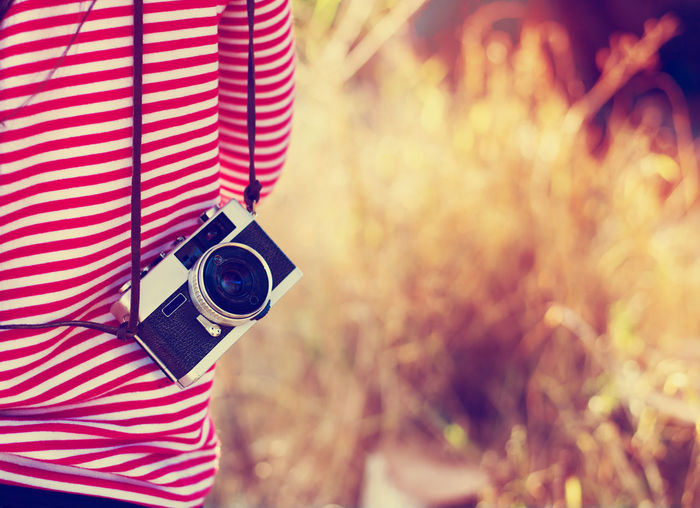 Vintage young hipster girl photographer with retro camera in holiday travel Autumn Travel Woman Camera Camera - Photographic Equipment Close-up Day Film Camera Hipster Lifestyles One Person People person Photographer Photographing Photography Themes Retro Styled SLR Camera Summer Technology Tourism Vintage
