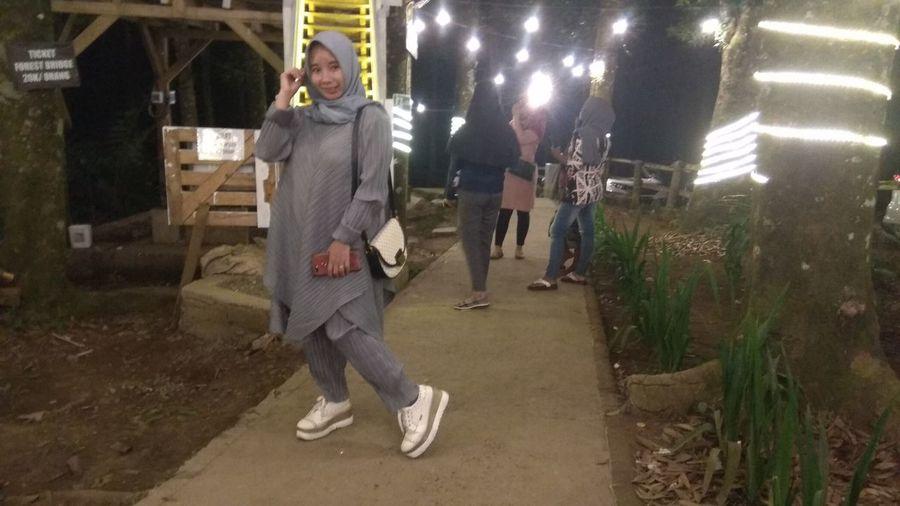 Full length portrait of woman walking outdoors