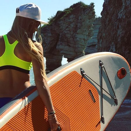 Sport Leisure Activity Adventure One Person Real People Vacations Outdoors Day Lifestyles Young Adult Women One Woman Only Only Women Extreme Sports Adults Only Adult Young Women People Nature Sky